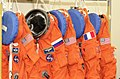 Launch and entry suits hang in readiness for the STS-111 crew (5135053006).jpg
