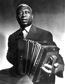 Lead Belly playing an accordion.