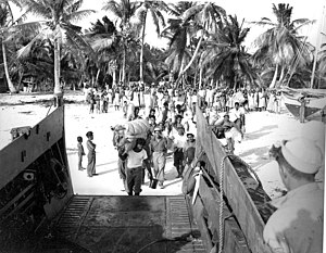 Bikini Atoll - 7 March 1946, 161 residents of Bikini Island board LST 1108 as they depart from Bikini Atoll