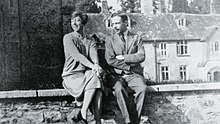 Leonard Elmhrist (R) with his wife, Dorothy, at Dartington Hall, Devon, UK.jpg