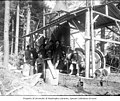 Logging crew posing in front of donkey engine, ca 1903 (INDOCC 641).jpg