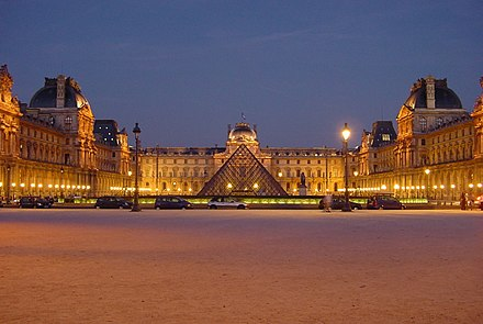 The Louvre in Paris Louvre at night centered.jpg