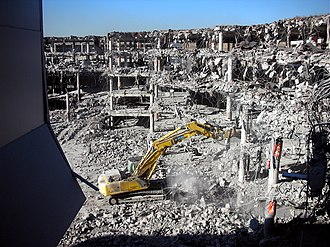 2006 Madrid–Barajas Airport bombing - Excavator removing debris from the blast on January 24