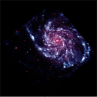 "Explorers Program - This artificially colored view of M101 maps ultraviolet light as blue while visible light is red since UV light does not have a ""color"" (the eye stopping at about violet). This view was taken by the Explorer SWIFT, which can also detect X-Rays, and has contributed to the study of Gamma-ray bursts and other topics"
