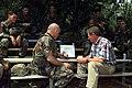 MGEN Leon Laport goes over battle plan for Task Force XXI (TFXXI) exercise with Senator James Inhofe.jpg