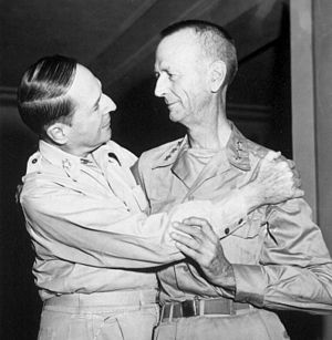 Jonathan M. Wainwright (general) - Wainwright (right) and MacArthur greet, August 1945.