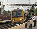 Manchester Train at Cheadle Hulme - geograph.org.uk - 1496398.jpg