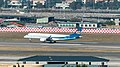 Mandarin Airlines Embraer 190 B-16822 on Final Approach at Taipei Songshan Airport 20150104c.jpg
