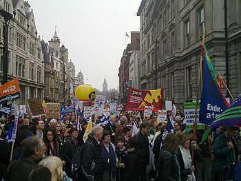 English: Demonstrators march up Whitehall in L...