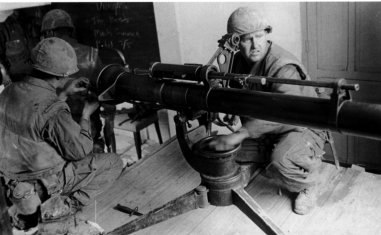 Marines firing a 106mm recoilless rifle from classroom in Hue University