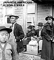 May 9, 1942 farm families wait for bus to Tanforan Assembly Center with 595 others from near Centerville CA., photo by Dorothea Lange, from- Japanese Americans in World War II, a National Historic Landmark theme study (page 1 crop).jpg