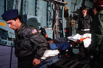 Medics from the 2nd Aeromedical Evacuation Squadron remove wounded Afghan freedom fighters from a C-141B Starlifter aircraft DF-ST-89-01809.jpg