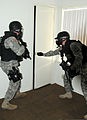 Members of the Special Reaction Team with the 178th Military Police Detachment, 89th Military Police Brigade, raid a house in Wainwright Village during a new training exercise at Fort Hood, Texas, March 5 130305-A-PK277-061.jpg