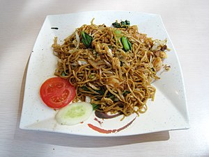 Chinese Indonesian cuisine - Mie goreng, a Chinese dish completely assimilated into Indonesian mainstream cuisine