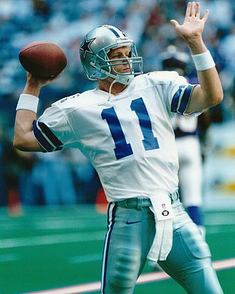 Quarterback - Mike Quinn, former Dallas Cowboys quarterback, throwing the football.