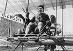 Mikhail Effimov, Russian aviator, full-length portrait, seated on airplane, facing front (cropped).jpg