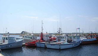 Miscou Island - View of fishing boats on Miscou Island, showing the Miscou Island Bridge in the background.
