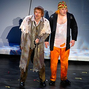 "Mitchell and Webb - Mitchell (right) as ""Ginger"" on stage with Webb as ""Sir Digby Chicken Caesar"" during a performance of their The Two Faces of Mitchell and Webb stage tour"