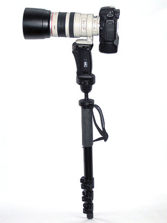 Monopod - Camera and telephoto lens mounted on monopod