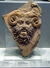 Greco-Roman-style sculpture of the face of a man with a beard and ram's horns