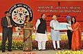 Narendra Modi presenting the award to Ms. Priya Sharma for design the logo of the 'Pradhan Mantri Jan Dhan Yojana (PMJDY)', in New Delhi. The Union Minister for Finance, Corporate Affairs and Defence, Shri Arun Jaitley.jpg