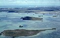 Nassau, taking off. Islands in shallow lagoon. 2 boats (38840256642).jpg