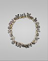 Necklace with Bird, Circle and Cylinder Beads MET DT261719.jpg