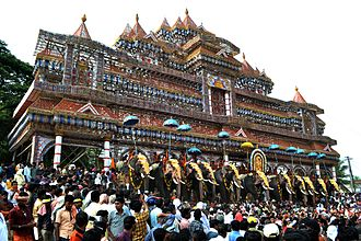 Vallanghy Nenmara Vela - The decorated elephants bearing the idol of deity at the nemmara vela pandal