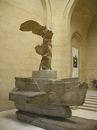 Hellenistic-era warships - The famous 2nd century BC Nike of Samothrace, standing atop the prow of an oared warship, most probably a trihemiolia.