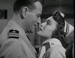 Patricia Neal en John Wayne in Operation Pacific