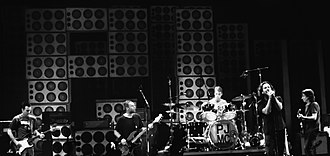 Pearl Jam - Pearl Jam performing in 2012-from left to right: Mike McCready, Jeff Ament, Matt Cameron, Eddie Vedder and Stone Gossard