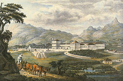 A colored lithograph depicting a large, white palace complex with a carriage entering a paved forecourt and forested mountains rising in the background.