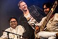 Pandit Vikash Maharaj, Nils (Wise Guys) and Abhishek Maharaj, during Tanzbrunnen, Cologne, Germany 2013.jpg
