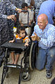 Paratroopers, National Police distribute wheelchairs in 9 Nissan DVIDS181361.jpg