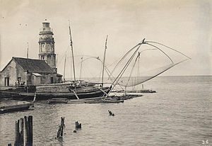 Pasig River Light - The Pasig Lighthouse at a different angle showing the tangent sides of the tower. In the center of the picture is a salambaw, a traditional Filipino fishing raft made from bamboo. Image was taken around 1900-1902.