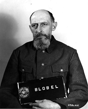 Syrets concentration camp - Paul Blobel, at the Nuremberg Military Tribunal, March 1948 (beard grown in prison)