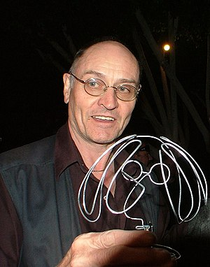 Paul Whitehead - Paul Whitehead with a wire sculpture of John Lennon.