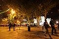 Pedestrians walking around the Puerta de Alcala, Madrid (6394593055).jpg