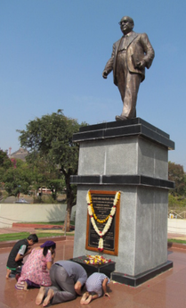 People paying tribute at the central statue of Bodhisattva Babasaheb Ambedkar in Dr. Babasaheb Ambedkar Marathwada University, India