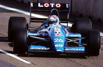 Philippe Alliot - Alliot driving the Ligier JS33B at the 1990 United States Grand Prix.