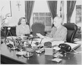 Photograph of President Truman at work at his desk in the Oval Office, dictating to his secretary, Rose Conway. - NARA - 199480.tif