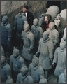 Photograph of The Reagans standing with the Terra Cotta figures in Xi'an, China - NARA - 198547.tif