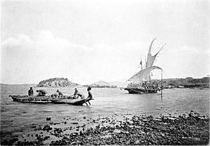 Lakatoi - Loading a lakatoi at Port Moresby, prior to 1885.