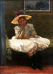 A girl in a hat with flowers.