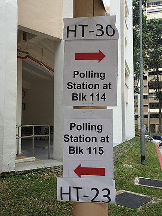 Singaporean general election, 2015 - Signs pointing to polling stations in Clementi, in Holland-Bukit Timah GRC