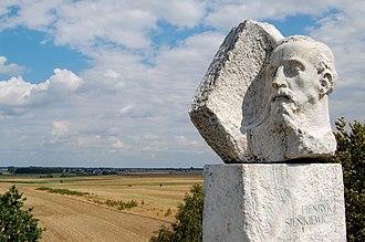 Henryk Sienkiewicz - Monument atop Sienkiewicz Mound at Okrzeja.  At left is the writer's family's village, Wola Okrzejska, where he was born.
