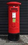 Post box at Whiston Post Office, Merseyside.jpg