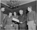 President Harry S. Truman (fourth from left) is presented with a bound volume of the German edition of the Stars and... - NARA - 198696.tif