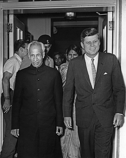 President of United States John F. Kennedy and President of India, Sarvepalli Radhakrishnan (left), depart the White House following a meeting. Minister of External Affairs of India, Lakshmi N. Menon, walks behind President Kennedy at West Wing Entrance, White House, Washington, D.C on 4 June 1963