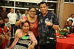 President Rodrigo Duterte does a fist gesture with a victim of the Davao bombing.jpg